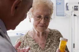 Added value as independent pharmacist helps older patient understand medication and how to take the medicine.